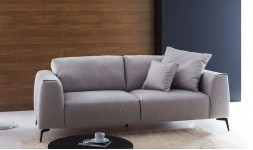 Canapé design en tissu et pieds fins en métal