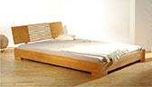 lit en bois naturel 2 places
